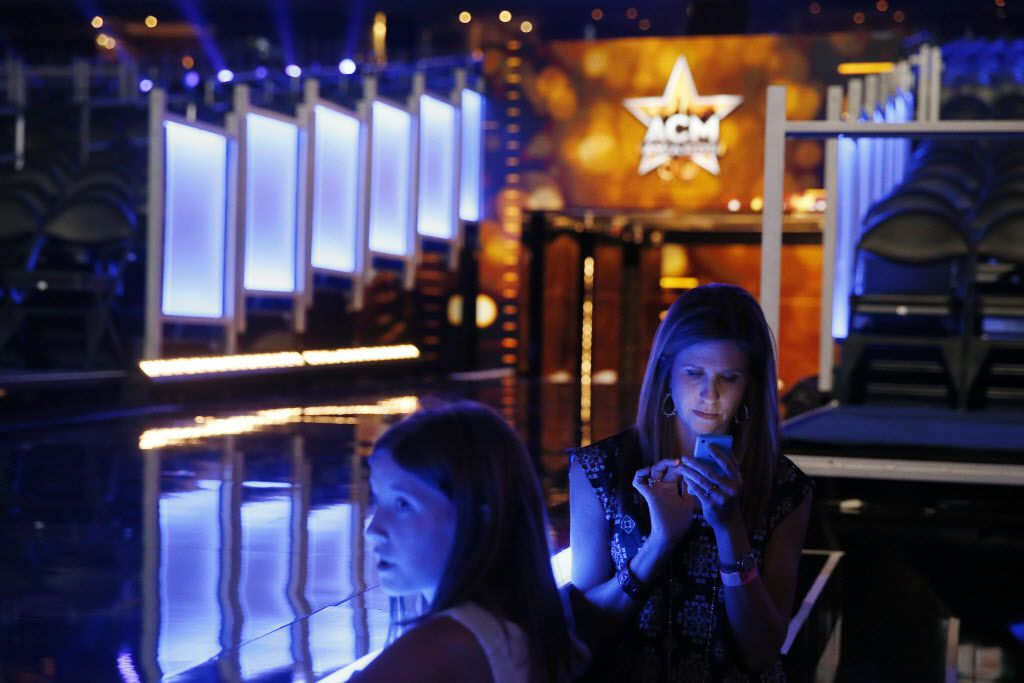 Ashley Turner (right), and her daughter, Sinclair Turner, 12, of Birmingham, Alabama, stand by the center stage before the 2015 Academy of County Music Awards Sunday, April 19, 2015 at AT&T Stadium in Arlington, Texas.