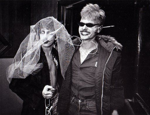 Two unidentified fans arrive at the Longhorn Ballroom for the Sex Pistols concert on Jan. 10, 1978.