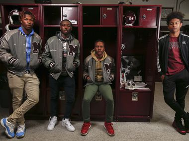 Senior Mesquite football players Alec Rice, left, Ja'Darion Smith, Gary Green, and De'Wayne Adams pose for a photograph next to the locker of their former classmate and Mesquite football player Jordan Edwards, on Thursday, Oct. 31, 2019 in Mesquite, Texas. Edwards would have been a senior member of the Mesquite football team this year. Instead, he was murdered by a Balch Springs police officer two years ago. Students have made the locker a permanent reminder of Edwards, leaving behind notes, mementos, and decorating for homecoming.