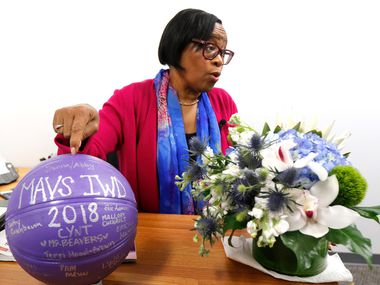 "Dallas Mavericks interim CEO Cynt Marshall points to a basketball in her new office that was given to her by women employees at the Dallas Mavericks office.  She also received several flower arrangements from friends and a dozen yellow roses from to the California NAACP who wished her success as she begins her new venture, Friday, March 16, 2018. After 36 years, Cynt left AT&T after achieving ""rock star"" status, according to co-workers. She left to launch a consulting firm focused in part on leadership and inclusion. (David Woo/The Dallas Morning News)"