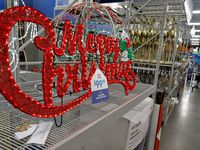 A large Christmas sign on display at the At Home store on Hwy. 121 in Plano.