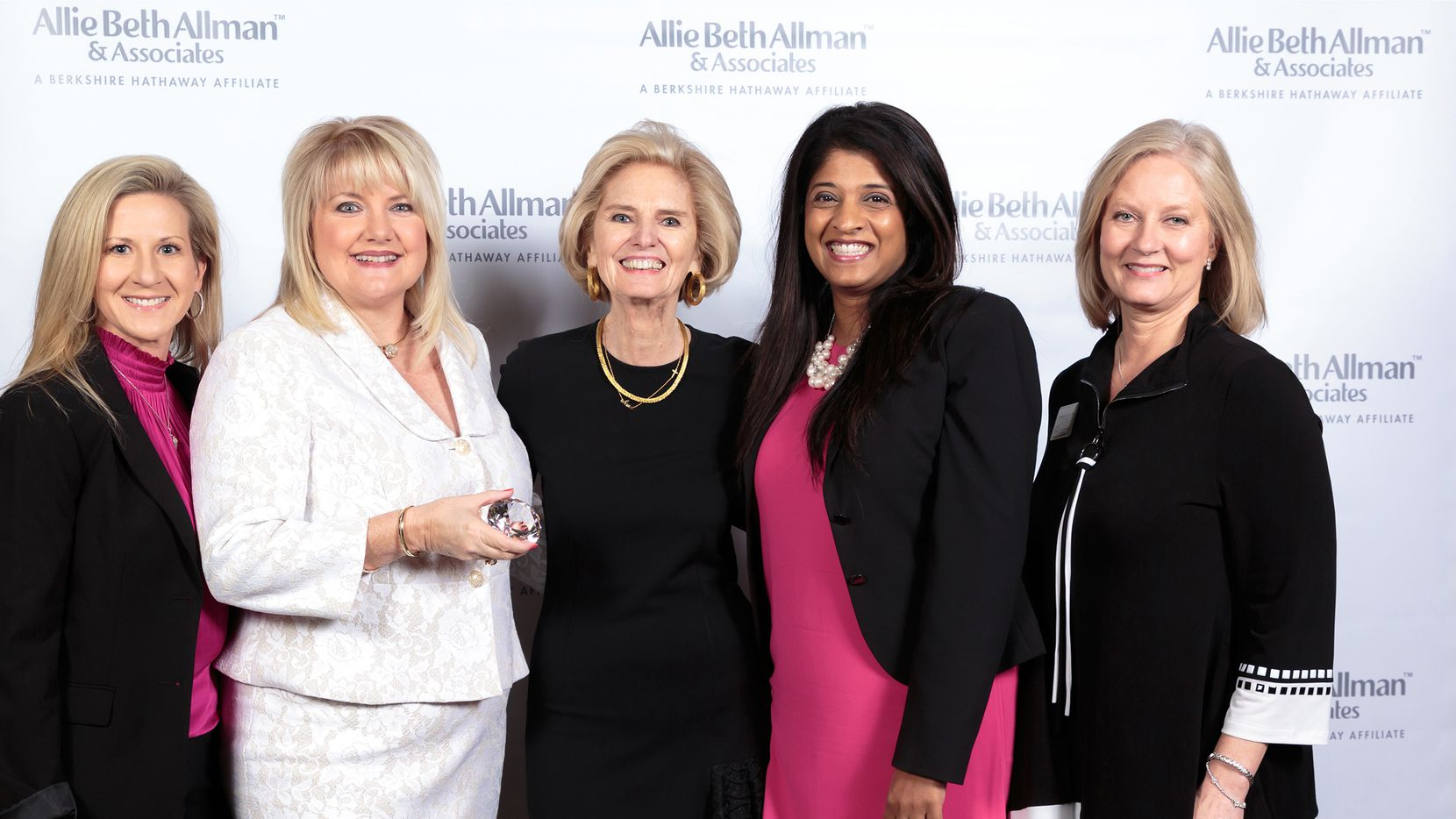 President/CEO Allie Beth Allman (center) congratulates the Dona Robinson Group for being named Top Producing Team for 2019.