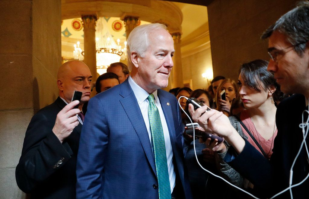 Sen. John Cornyn, R-Texas, stops to speak to members of the media as head off to join other GOP Senators for a close-door meeting, Monday, Jan. 22, 2018, on Capitol Hill in Washington on day three of the government shutdown. (AP Photo/Pablo Martinez Monsivais)