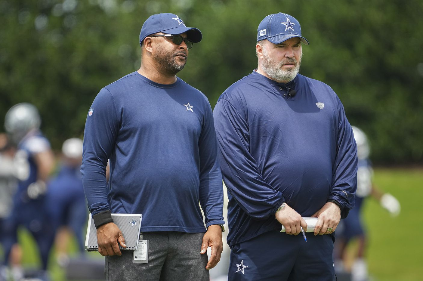 Dallas Cowboys head coach Mike McCarthy (right) and vice president of player personnel Will McClay watch their team run drills during a minicamp practice at The Star on Tuesday, June 8, 2021, in Frisco. (Smiley N. Pool/The Dallas Morning News)