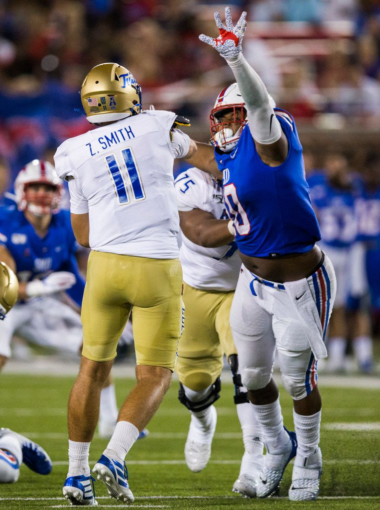 SMU Mustangs defensive tackle Demerick Gary (10) gets a penalty for roughing the passer as he hits Tulsa Golden Hurricane quarterback Zach Smith (11) during the second quarter of an NCAA football game between Tulsa and SMU on Saturday, October 5, 2019 at Ford Stadium on the SMU campus in Dallas. (Ashley Landis/The Dallas Morning News)