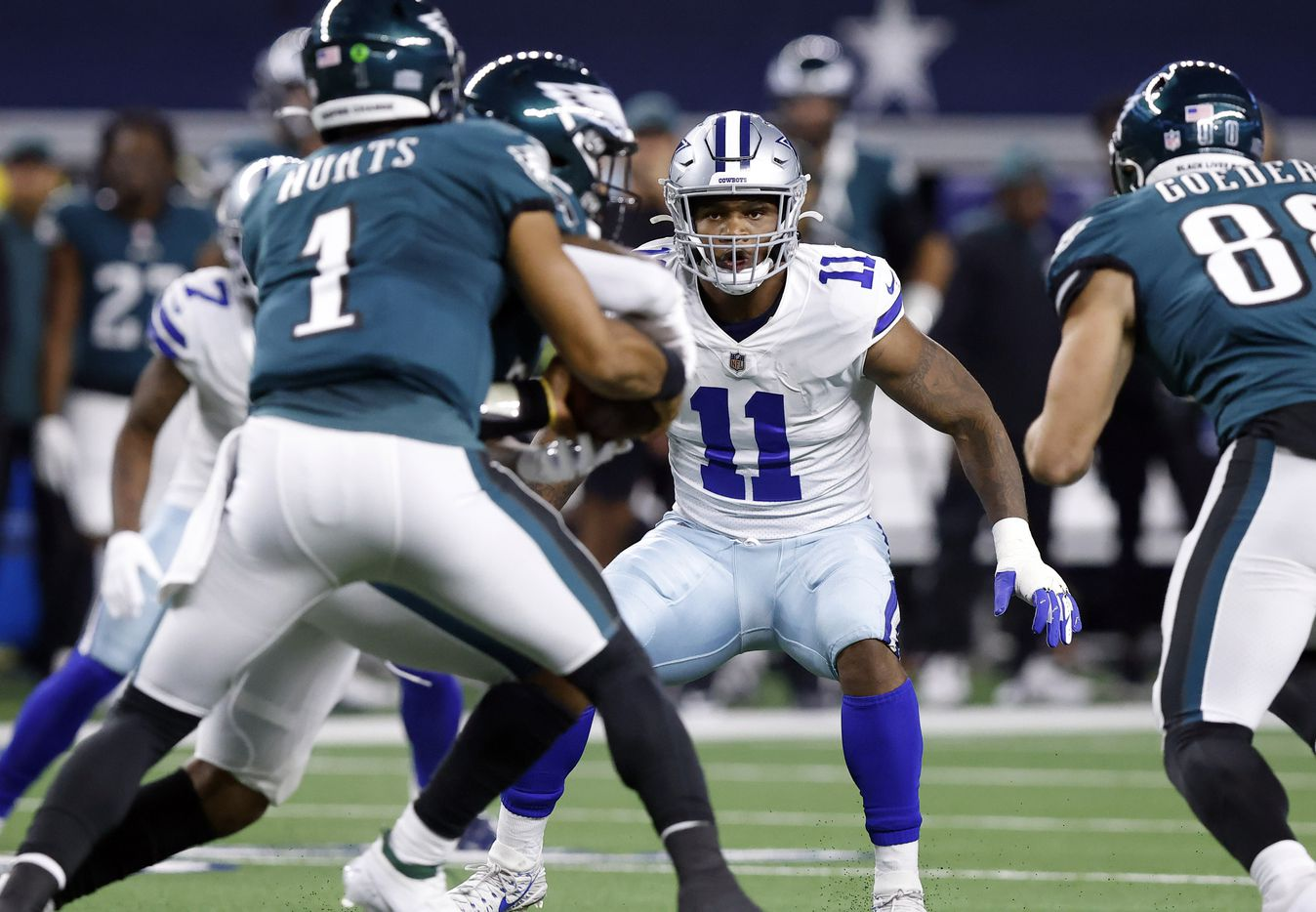 Dallas Cowboys linebacker Micah Parsons (11) looks to cover a fake handoff by Philadelphia Eagles quarterback Jalen Hurts (1) during the second quarter at AT&T Stadium in Arlington, Monday, September 27, 2021. (Tom Fox/The Dallas Morning News)