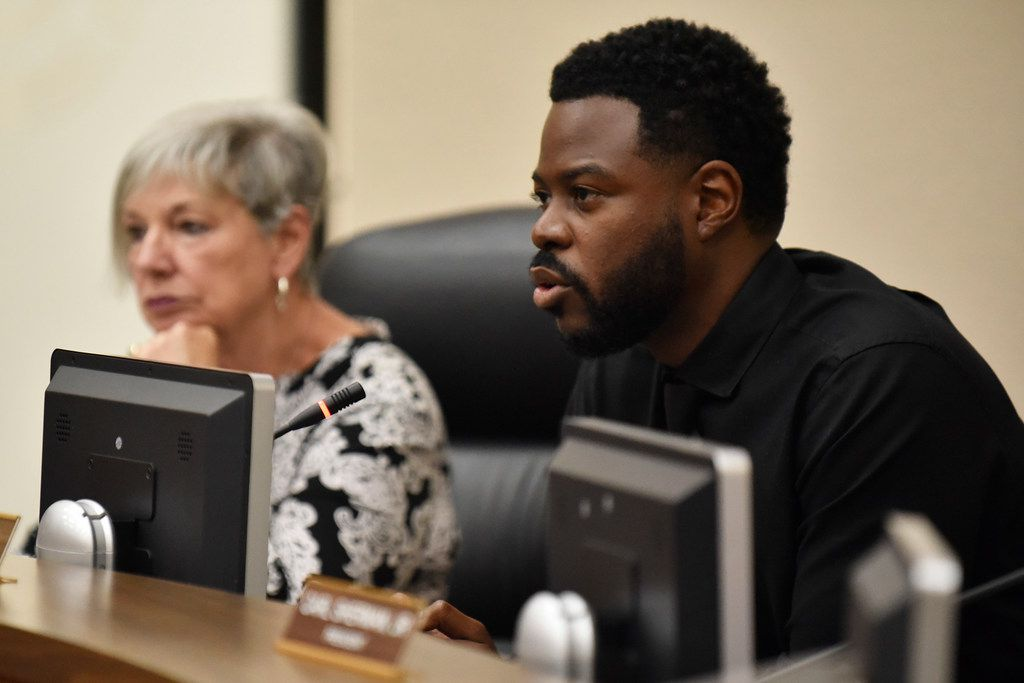 DeSoto schools Superintendent D'Andre Weaver (right) seen here at a 2019 school board meeting. He and trustees are working with a state-appointed conservator to right the district.