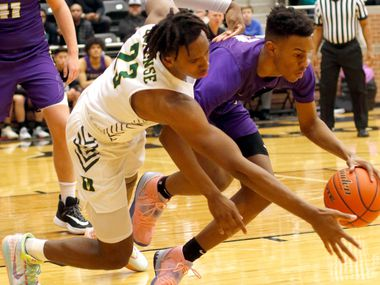 Richardson's Rylan Griffen (right) battles DeSoto's Tavion Carroll for a loose ball during Richardson's 63-51 win in Monday's Class 6A bi-district playoff game. Griffen scored a game-high 29 points. (Steve Hamm/Special Contributor).