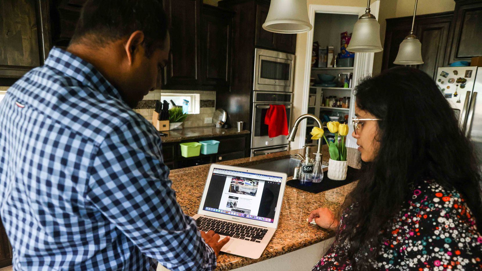 Kartheek Veeravalli (left), 36, and Gowri Pujitha Appana, 31, of Euless work on their GiveIndia.org site, which is helping rural areas in India fight the second wave of the pandemic.