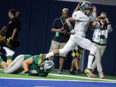 The Colony Myles Price (2) scores a touchdown against Frisco Reedy defensive tackle Brock Miller (95) in the first half of their non district football game on Thursday, Sept. 6, 2018 at The Ford Center at The Star in Frisco, Texas.