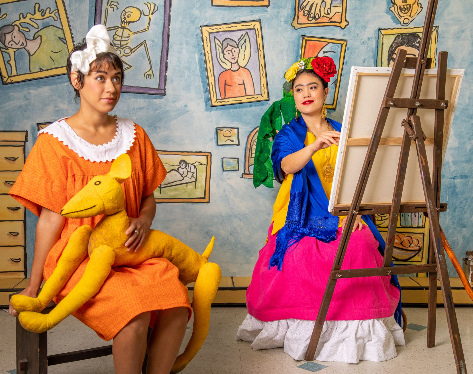 """Mariana (soprano Robin Steitz) sits for a portrait with the great Mexican artist Frida Kahlo (mezzo-soprano Kayla Nanto) in the Fort Worth Opera's """"Frida Kahlo and the Bravest Girl in the World,"""" which is streaming online for students."""