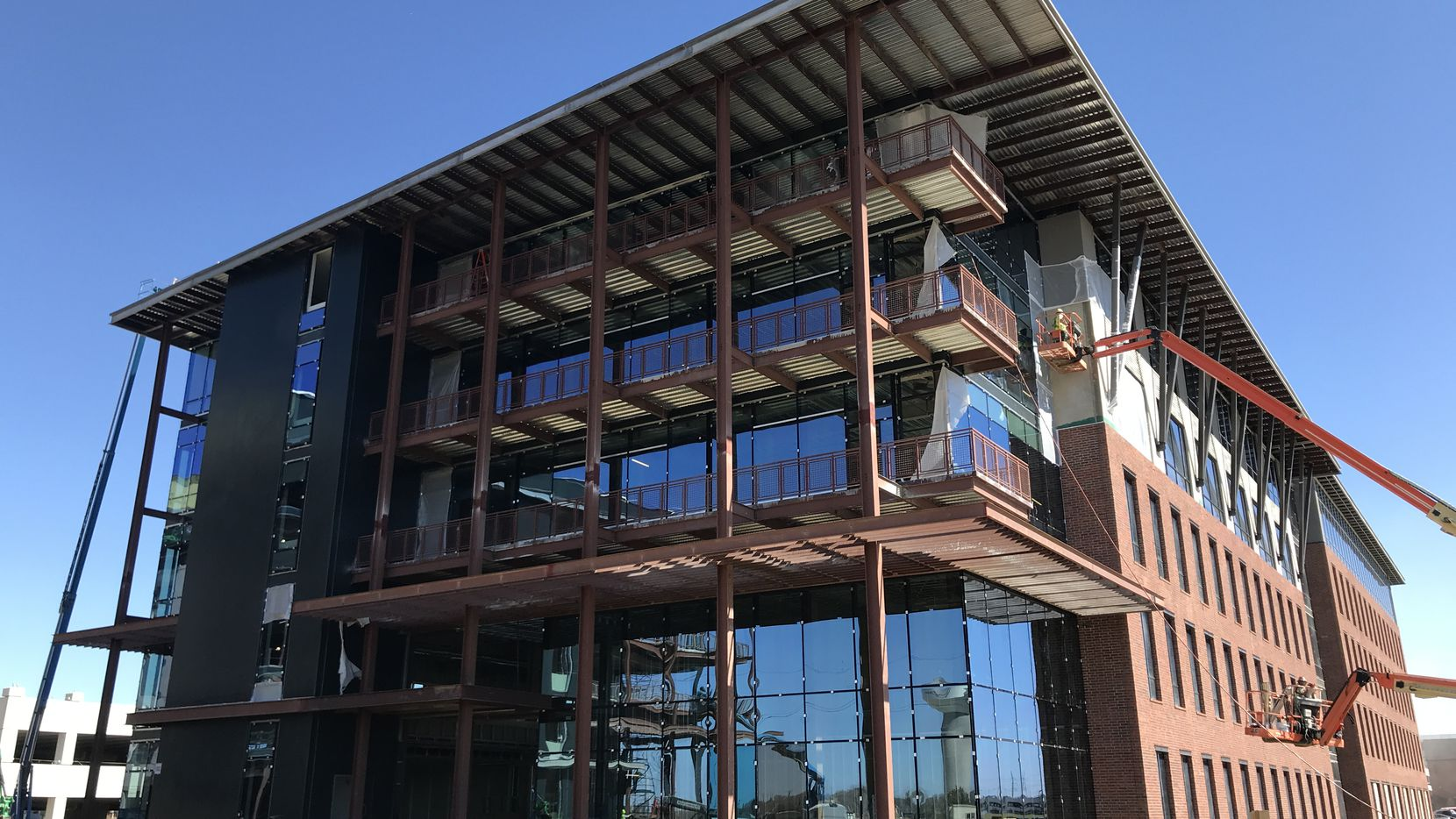 Two new office buildings are opening at Cypress Waters in May and June.