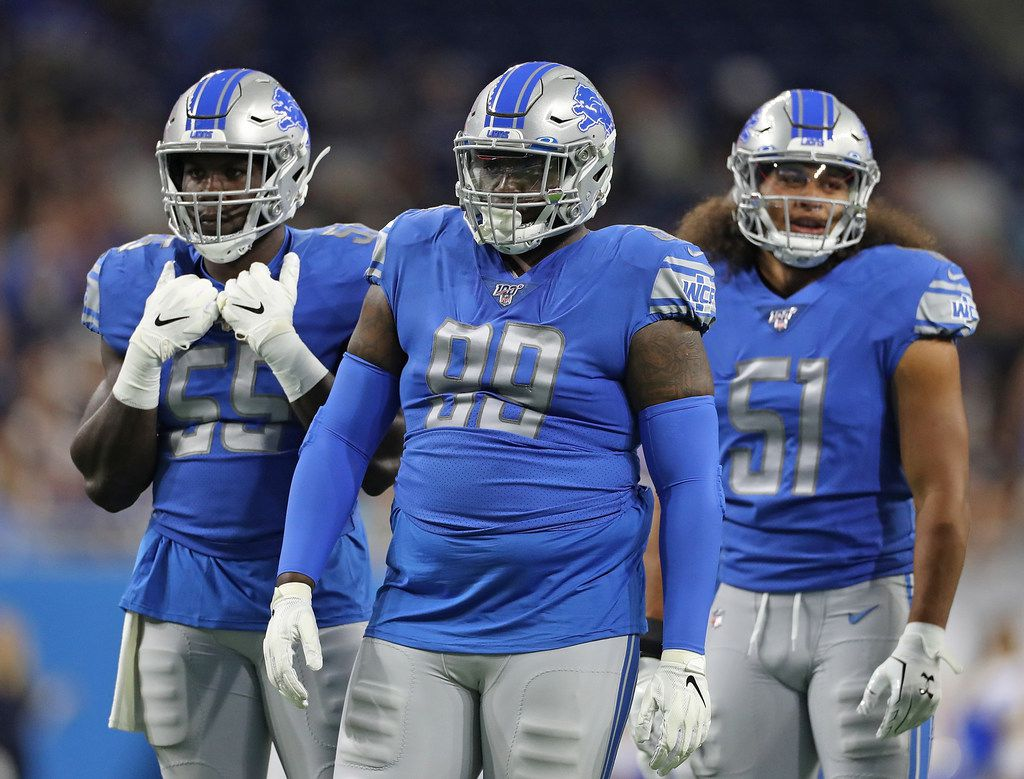 DETROIT, MI - AUGUST 8: Trey Flowers #90, Eric Lee #55 and Jahlani Tavai #51 of the Detroit Lions line up during the preseason game against the New England Patriots at Ford Field on August 8, 2019 in Detroit, Michigan. New England defeated Detroit 31-3.