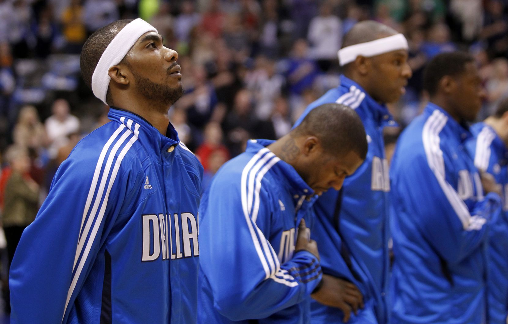 Mavericks shooting guard Corey Brewer (13) during the national anthem before an NBA game between the Dallas Mavericks and the Indiana Pacers at American Airlines Center in Dallas, on March 4, 2011.
