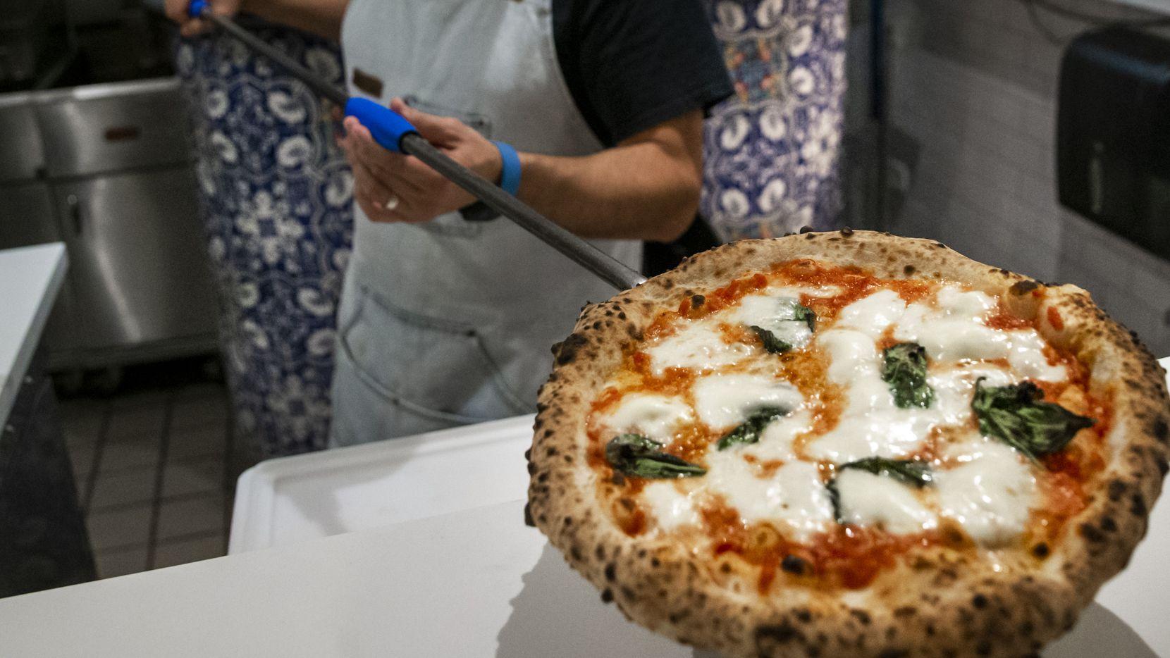 Chef Dino Santonicola prepares a margherita pizza at Partenope Ristorante in downtown Dallas.