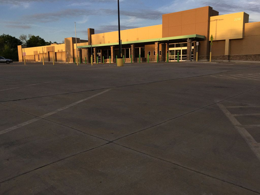 The former WalMart site at Greenville and Belmont avenues in Dallas, shown April 9, 2018, has sat vacant since 2016. The property landlord is Mitchell Rasansky, the former council member for District 13 in northwest Dallas.