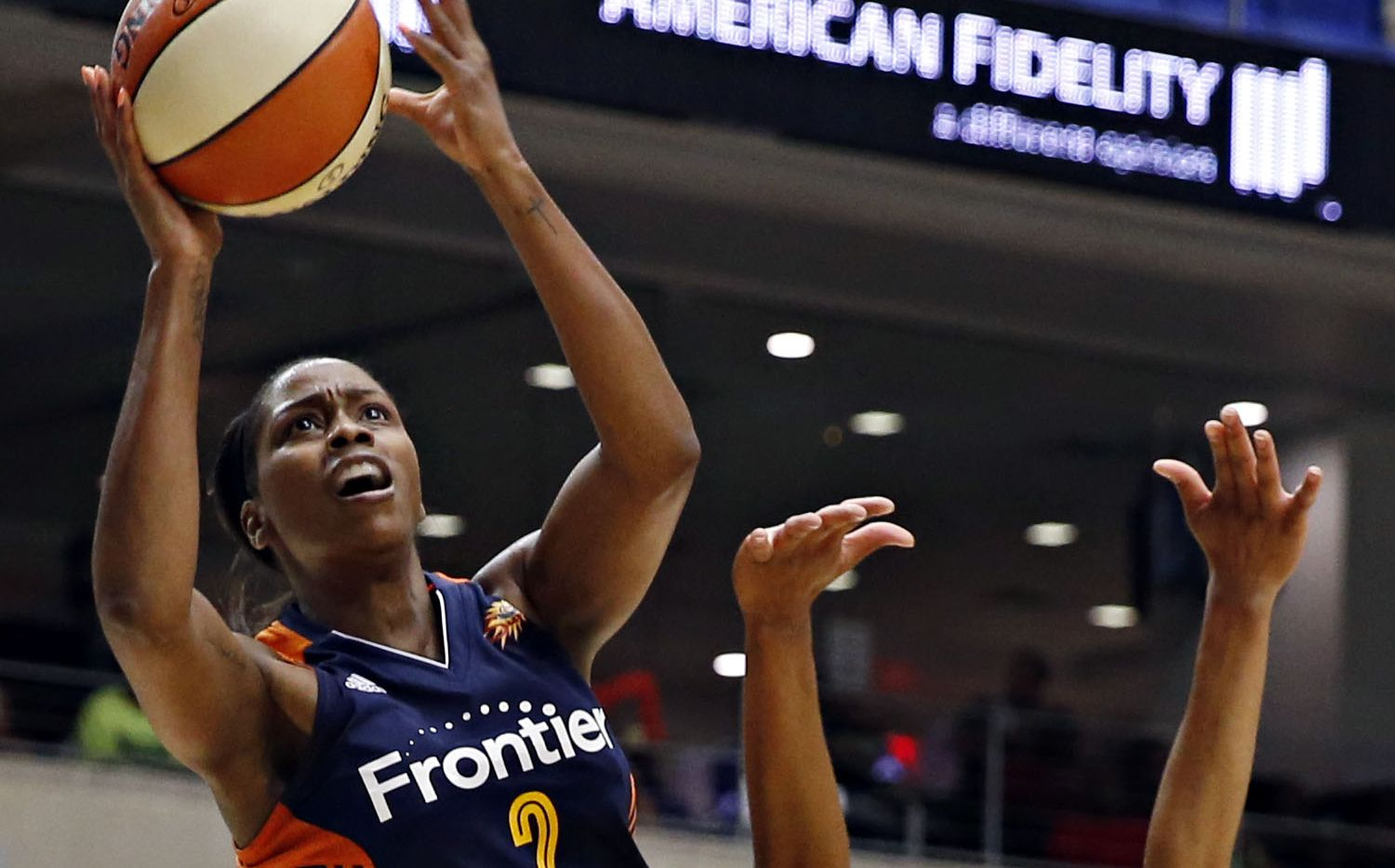 Connecticut Sun forward Camille Little (2) gets by Dallas Wings forward Aerial Powers during the first half of their game Saturday, July 2, 2016 at College Park Center in Arlington, Texas.