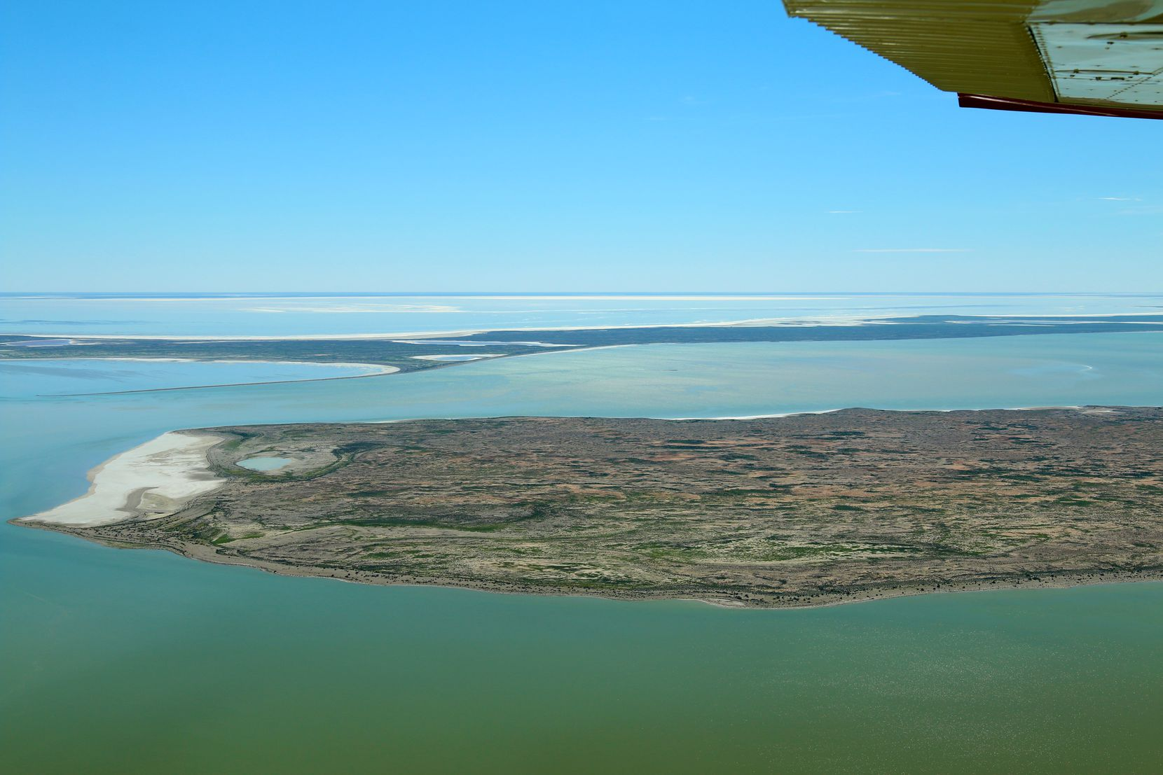 Flying over Kati Thanda-Lake Eyre is a once-in-a-lifetime treat. See it in flood, and you'll join a select, lucky few.