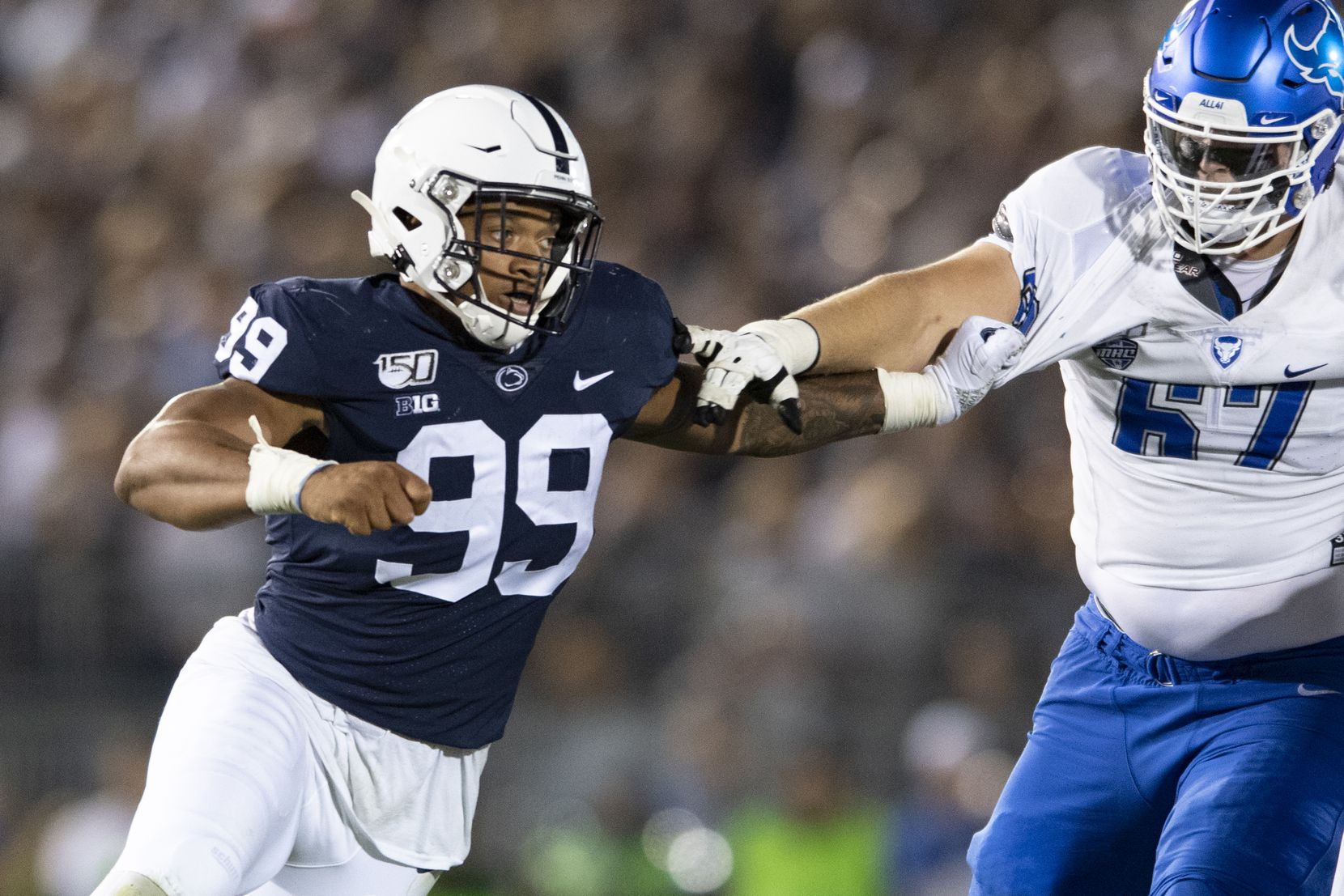Penn State defensive end Yetur Gross-Matos (99) fights off a block by Buffalo offensive lineman Evin Ksiezarczyk (67) in the third quarter of an NCAA college football game in State College, Pa., on Saturday, Sept. 7, 2019.