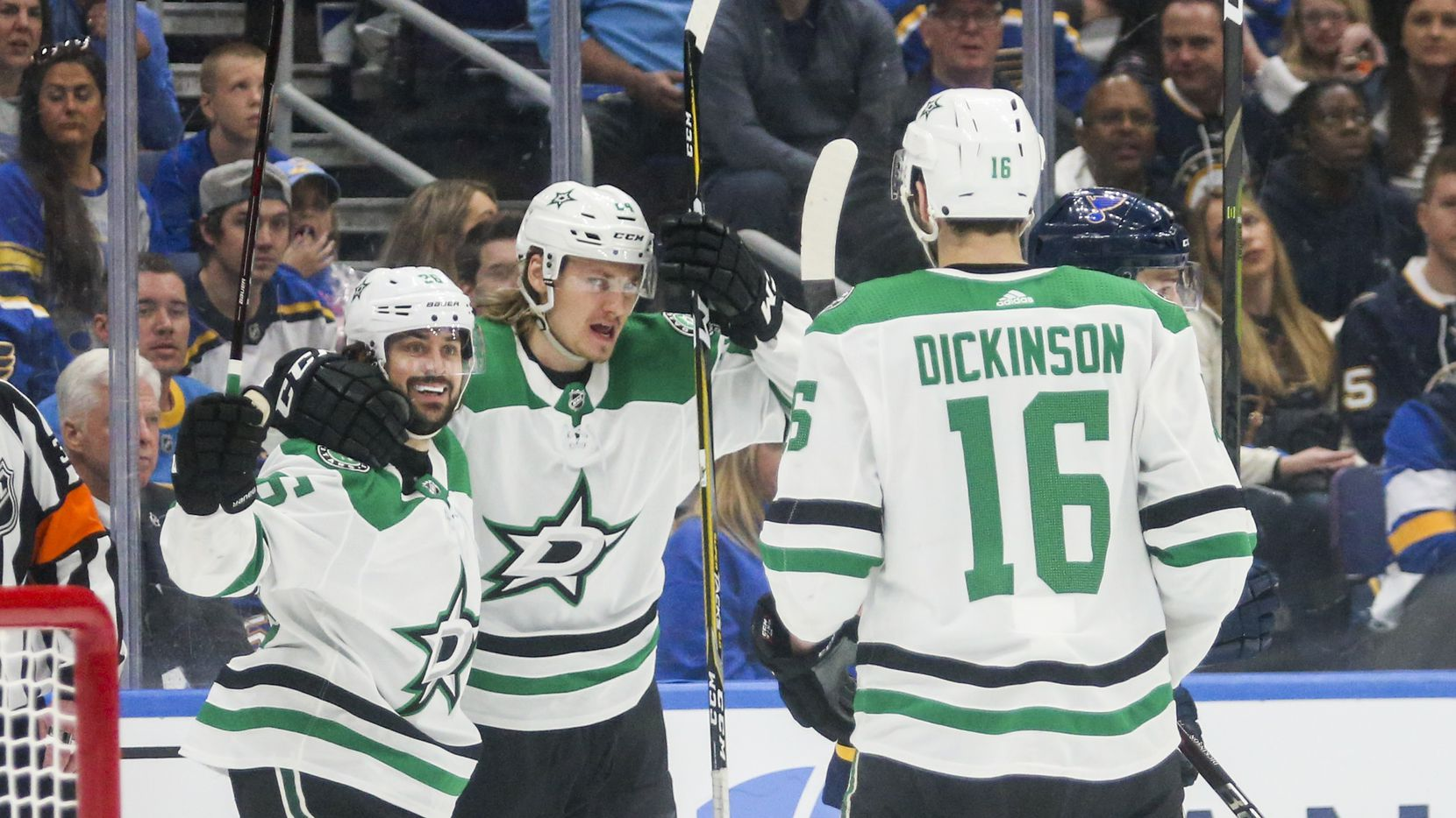 Dallas Stars center Mats Zuccarello (36), left wing Roope Hintz (24) and center Jason Dickinson (16) celebrate after scoring on St. Louis Blues goaltender Jordan Binnington (50) during game 2 of an NHL second round playoff series at Enterprise Center in St. Louis, Missouri on Saturday, April 27, 2019.(Shaban Athuman/Staff Photographer)