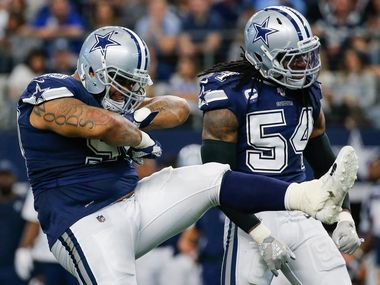 Dallas Cowboys defensive tackle Antwaun Woods (99) and middle linebacker Jaylon Smith (54) celebrate a stop during the first half of an NFL matchup between the Dallas Cowboys and the Los Angeles Rams on Sunday, Dec. 15, 2019 at AT&T Stadium in Arlington, Texas.
