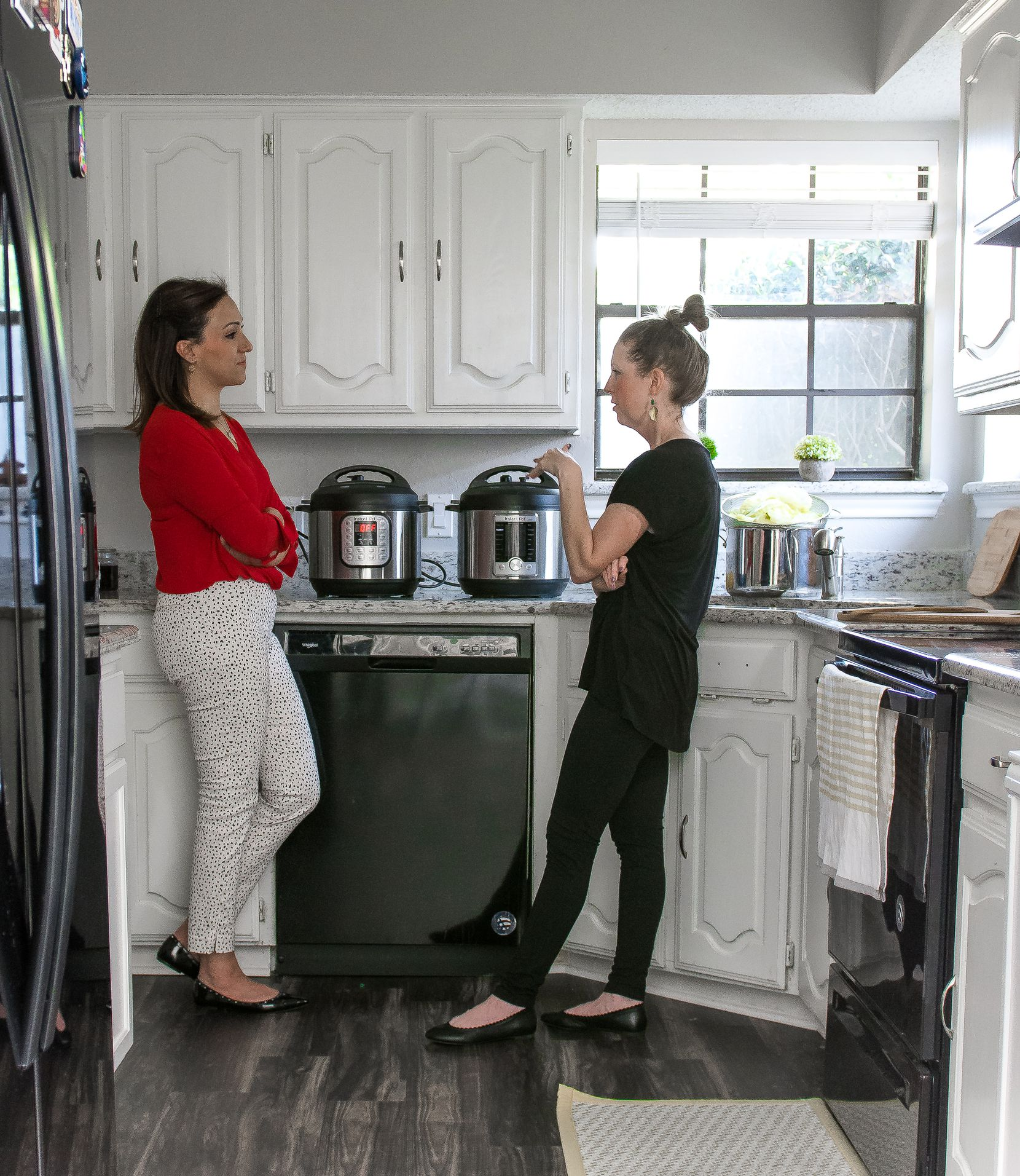 Tamara Abuomar and author Rebecca White chat while cooking in Tamara's Plano home.