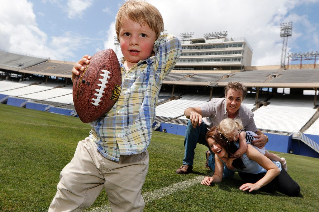 Walker, not yet 2, and his sister, Marlowe, who turns 3 in September, are the only grandchildren of Dallas Cowboys great Don Meredith. Here, Walker plays football with his family. His father is Michael Meredith, an independent film director, screenwriter and producer and the only son of Don Meredith. Amit Nizan Meredith is Michael's wife and the mother of Walker and Marlowe. They were photographed at the Cotton Bowl in Fair Park in Dallas. (David Woo/The Dallas Morning News)