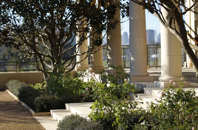 The Texas Rose Garden, outside the Bush library, offers a view beyond — to the skyline of downtown Dallas. Inside is a replica of the Oval Office during the Bush presidency.