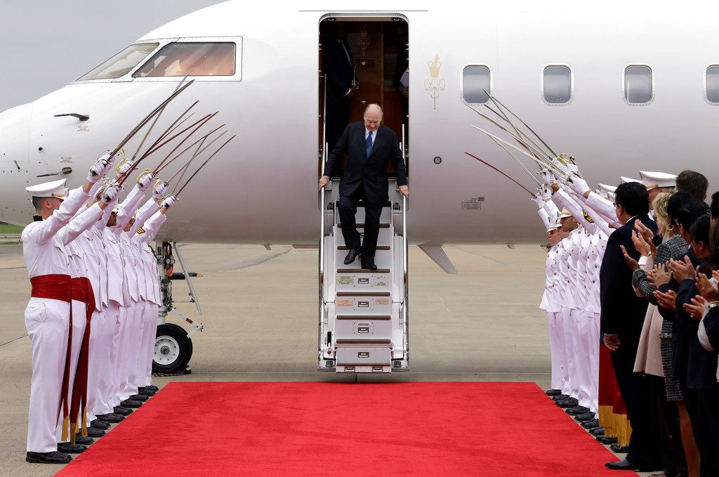 The Aga Khan exits his plane as the Texas A&M Ross Volunteer Company raises their swords on his arrival at Sugar Land Regional Airport on Sunday, March 18, 2018, in Sugar Land.