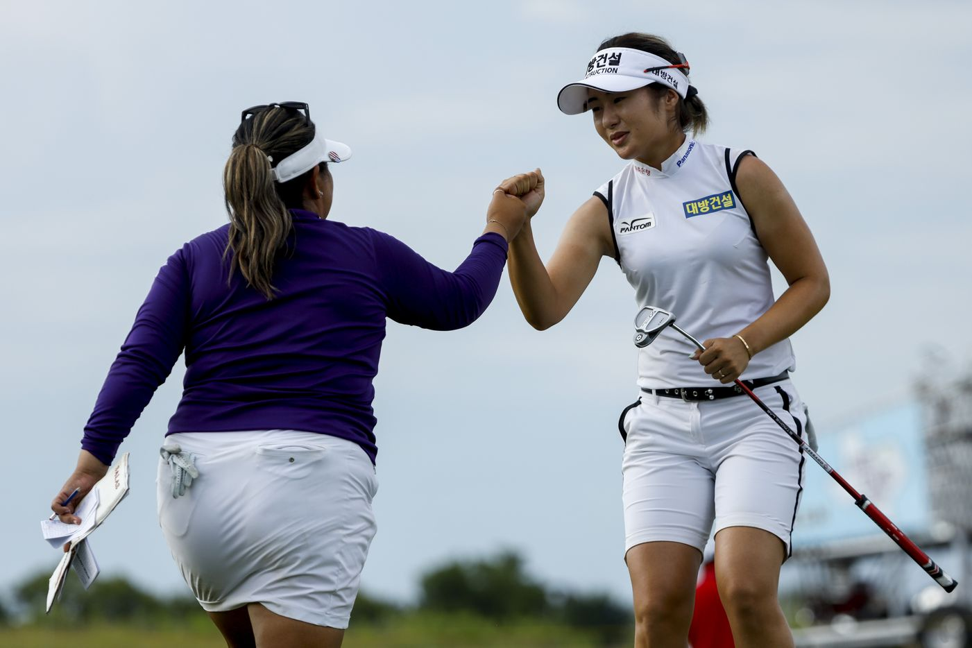 Professional golfers Jeongeun Lee6 (right) and Lizette Salas share a fist bump after round one of the LPGA VOA Classic on Thursday, July 1, 2021, in The Colony, Texas. Lee6 shot seven under par on the first day. (Elias Valverde II/The Dallas Morning News)