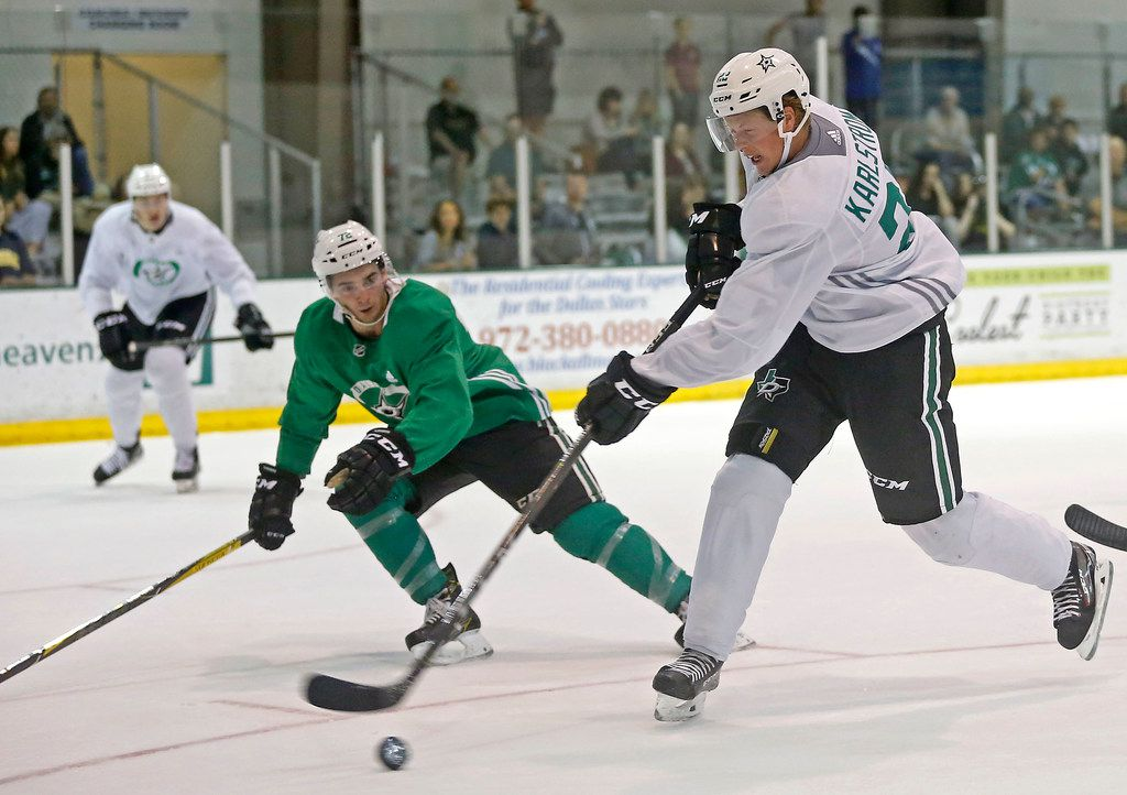 FILE - Stars forward Fredrik Karlstrom (22) takes a shot past defenseman Jeff Baum during a scrimmage at development camp at StarsCenter in Frisco on Friday, June 29, 2018.