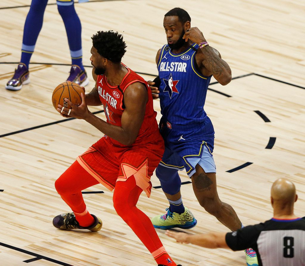 Team Giannis' Joel Embiid (24) posts up Team LeBron's LeBron James (2) during the second half of play in the NBA All-Star 2020 game at United Center in Chicago on Sunday, February 16, 2020. Team LeBron defeated Team Giannis 157-155. (Vernon Bryant/The Dallas Morning News)