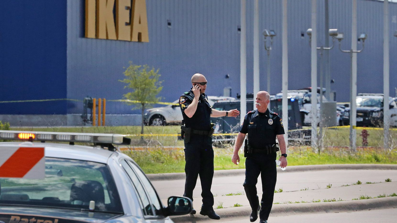 Grand Prairie police officers at the scene of a confrontation with an armed man  near the Ikea store Monday.