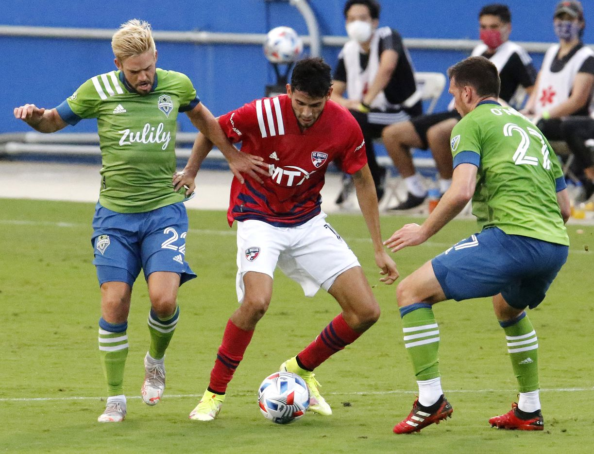 FC Dallas forward Ricardo Pepi (16) tries to get past Seattle Sounders midfielder Kelyn Rowe (22) and Seattle Sounders defender Shane O'Neill (27) during the first half as FC Dallas hosted the Seattle Sounders at Toyota Stadium in Frisco on Wednesday night, August 18, 2021.