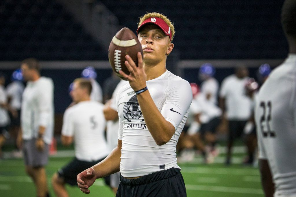 FILE - Quarterback Spencer Rattler, of Phoenix, tosses a ball around during the second day of The Opening at Ford Center at The Star in Frisco, Texas on July 1, 2018. The elite football camp, which stands across three days, was in Frisco for the first time. (Carly Geraci/The Dallas Morning News)