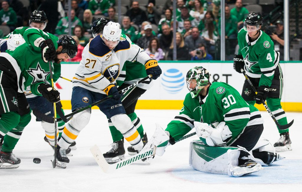Dallas Stars goaltender Ben Bishop (30) blocks a shot by Buffalo Sabres center Curtis Lazar (27) during the second period of an NHL game between the Dallas Stars and the Buffalo Sabres on Thursday, January 16, 2020 at the American Airlines Center in Dallas.