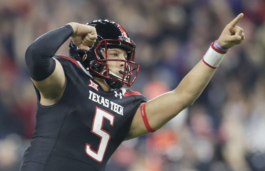 Dec 29, 2015; Houston, TX, USA; Texas Tech Red Raiders quarterback Patrick Mahomes (5) reacts after throwing a touchdown against the LSU Tigers in the first quarter at NRG Stadium. (Thomas B. Shea-USA TODAY Sports)