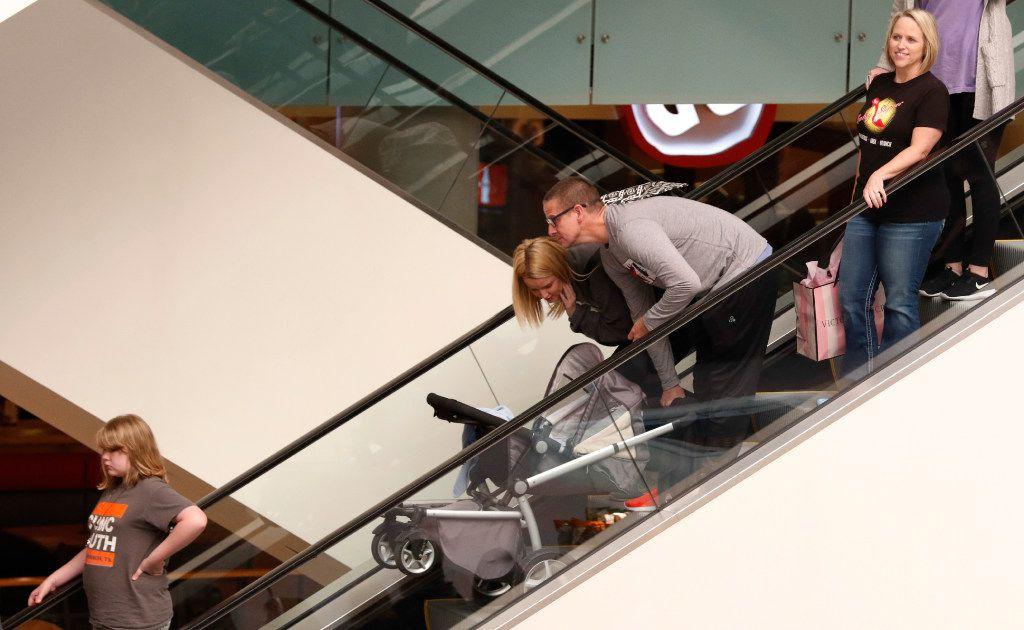 Shoppers ride an escalator at Galleria Dallas on Black Friday, November 25, 2016 in Dallas, Texas. (David Woo/The Dallas Morning News)