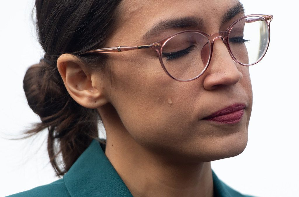 U.S. Rep. Alexandria Ocasio-Cortez, D-N.Y., sheds a tear during a press conference calling on Congress to cut funding for U.S.  Immigration and Customs Enforcement (ICE) and to defund border detention facilities, outside the US Capitol in Washington, D.C., Feb. 7, 2019.