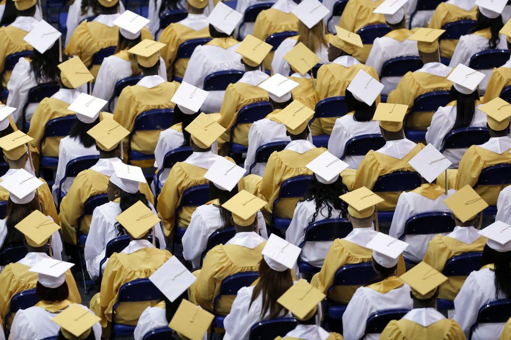 Members of the South Oak Cliff High School class of 2016 wait to receive their diplomas during a graduation ceremony at the Ellis Davis Field house in Dallas.