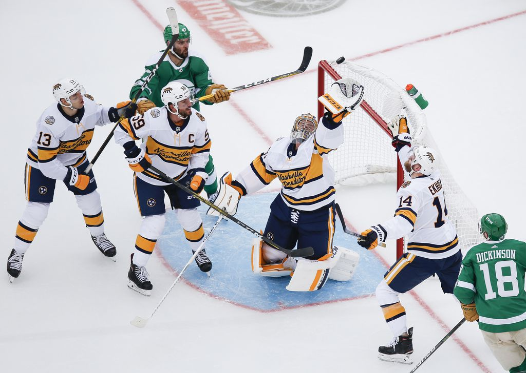 Nashville Predators goaltender Pekka Rinne (35) makes a save during the second period of a NHL Winter Classic matchup between the Dallas Stars and the Nashville Predators on Wednesday, January 1, 2020 at Cotton Bowl Stadium in Dallas. (Ryan Michalesko/The Dallas Morning News)