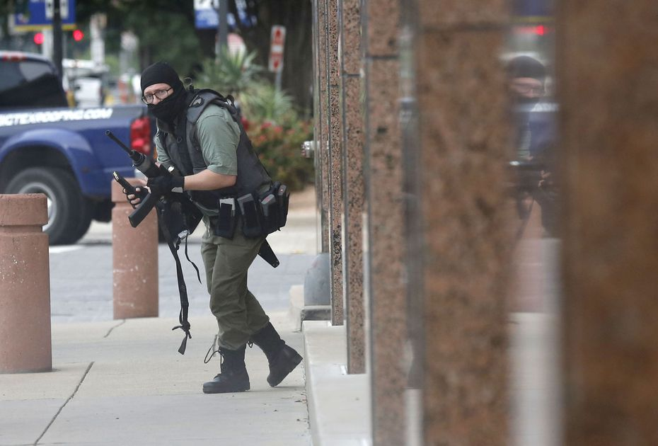 Armed with an AR-15 style rife, Brian Isaack Clyde (shown) attacks the Earle Cabell federal courthouse Monday morning, June 17, 2019 at the in downtown Dallas. This photo by Dallas Morning News photographer Tom Fox won for breaking news photography in the annual Sigma Delta Chi Awards from the Society of Professional Journalists.
