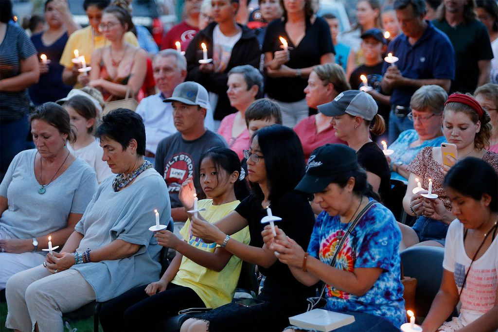 Area residents gather for a candle light vigil held at Dr. Glenn Mitchell Memorial Park in McKinney on Monday, August 5, 2019, for the victims of recent shootings.