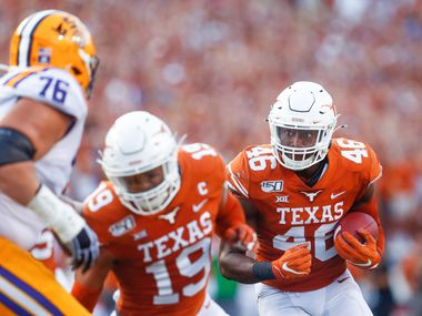 Texas Longhorns linebacker Joseph Ossai (46) recovers a fumbled LSU Tigers ball during the first quarter of a college football game between the University of Texas and Louisiana State University on Saturday, Sept. 7, 2019 at Darrell Royal Memorial Stadium in Austin, Texas.