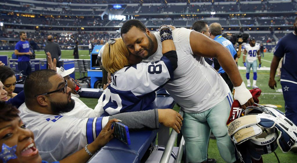 Dallas Cowboys defensive end Jeremy Mincey (92) receives a hug from super fan Carolyn Price after they lost to the Washington Redskins in their final game of the season at AT&T Stadium in Arlington, Texas, Sunday, January 3, 2016. The Cowboys lost 34-23. (Tom Fox/The Dallas Morning News)
