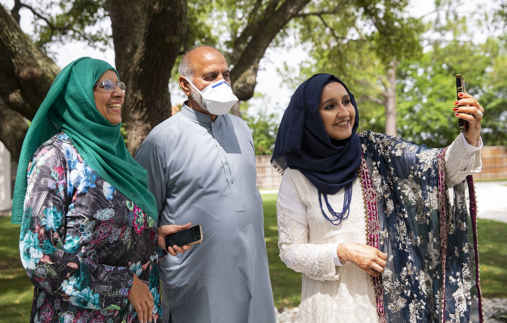 Yasmin Nadeem, (left to right) Nadeem Aziz and daughter Qudsia Nadeem celebrated Eid in Plano on Sunday by video chatting with relatives in Pakistan and Florida.