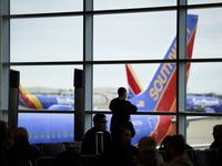 Passengers wait to board a Southwest Airlines flight at Dallas Love Field in January.