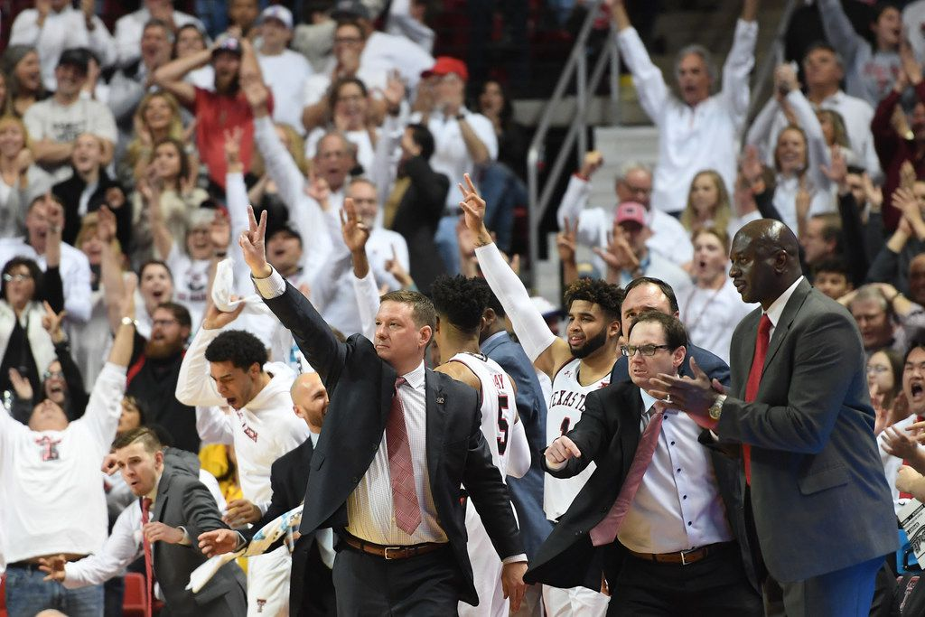 LUBBOCK, TX - FEBRUARY 13: Head coach Chris Beard and the bench of the Texas Tech Red Raiders react to a made three point shot during the second half of the game  against the Oklahoma Sooners on February 13, 2018 at United Supermarket Arena in Lubbock, Texas. Texas Tech defeated Oklahoma 88-78.