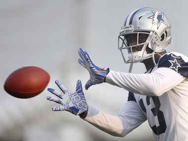 Cowboys wide receiver Michael Gallup (13) works on catching the ball in a drill during training camp at The Star in Frisco on Sunday, Aug. 16, 2020.