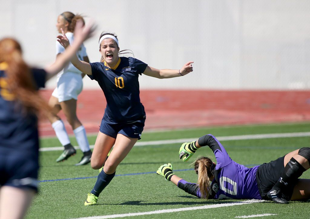 Highland Park's Presley Echols, celebrates her first goal, against Mansfield Lake Ridge's Brook Lampe, during Class 5A Regional II semifinals at Standridge Stadium, Carrollton on Friday, April 07, 2017. (Rick Moon/Special contributor)